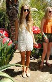 The DJ looked sweet in an ivory sleeveless lace dress, woven flats, round sunglasses, and a yellow crossbody bag at a Mulberry bash at Coachella.  7132117