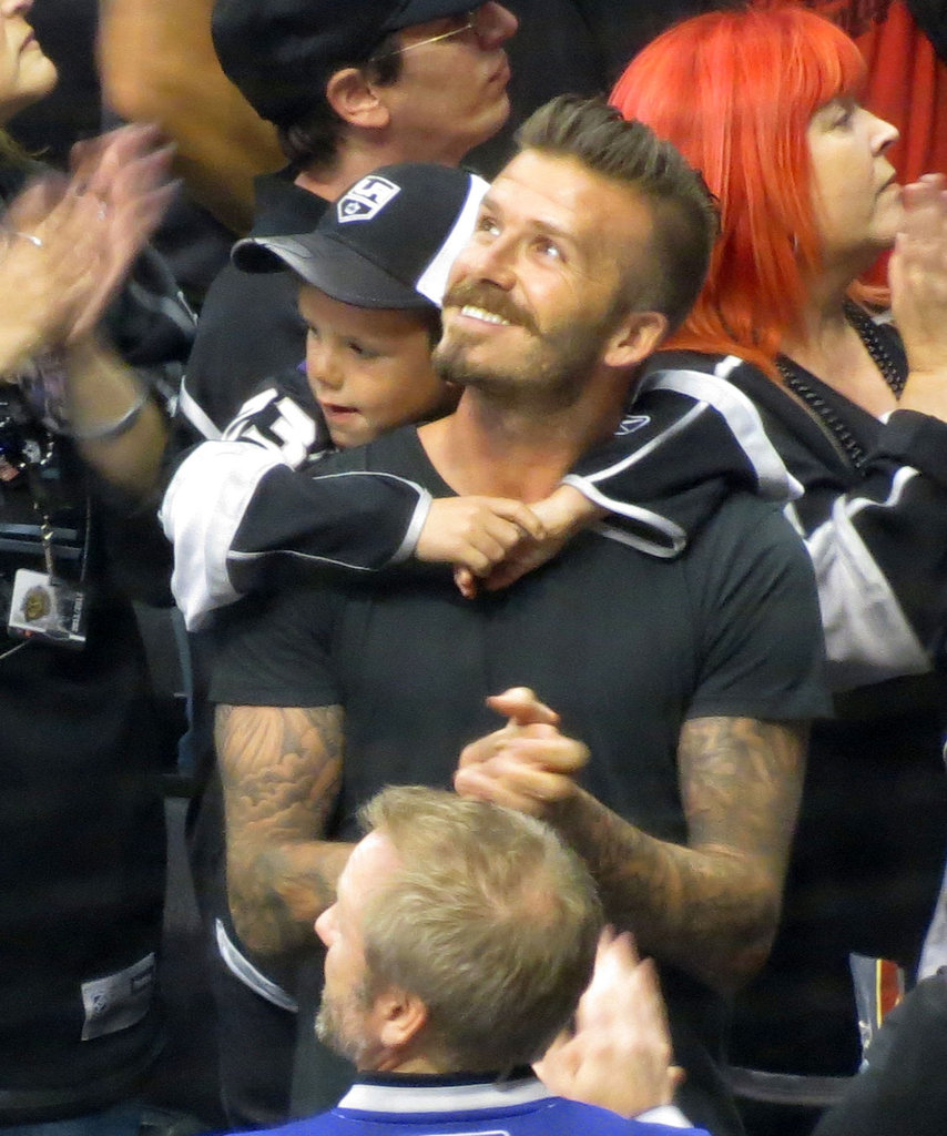 David Beckham cheered with son Cruz Beckham on his back at the LA Kings Stanley Cup final game in LA.