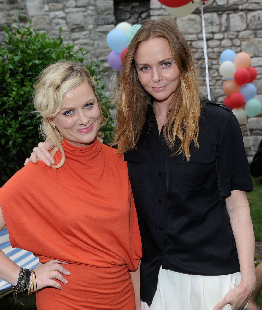 Amy Poehler smiled alongside designer Stella McCartney at her Spring presentation in NYC.