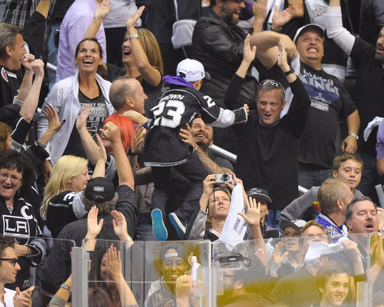 David Beckham celebrated by picking up his son Cruz, with brothers Romeo and Brooklyn nearby, at the LA Kings Stanley Cup final game in LA.