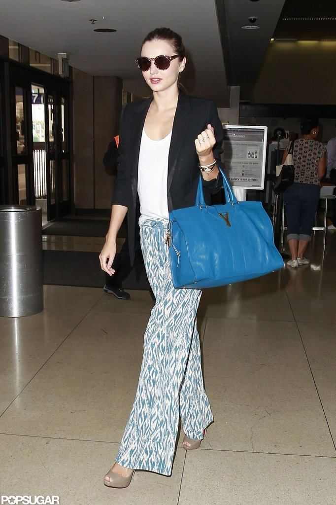 Miranda Kerr sported printed pants and shades at LAX.