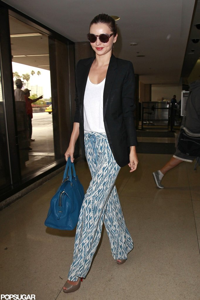 Miranda Kerr looked cute in a black blazer she paired with printed pants.