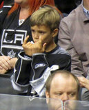 Romeo Beckham worked on his whistle at the LA Kings Stanley Cup final game in LA.