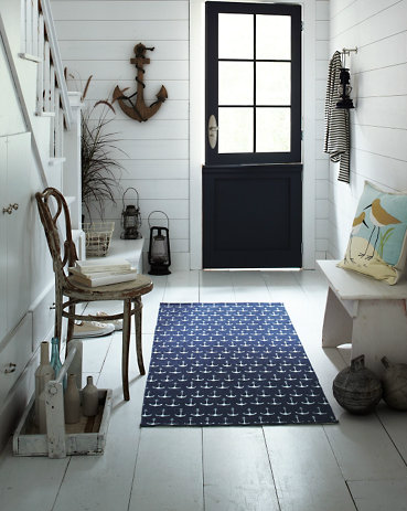 A deep navy blue creates the perfect backdrop for the Garnet Hill Printed Cotton Rug ($48).