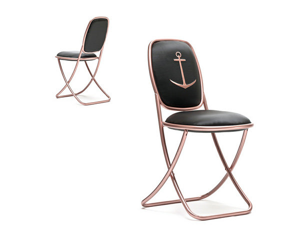 The Nika Zupanc Summertime Chair (inquire for price) features a gold tubular frame with outdoor fabric and anchor embroidery.