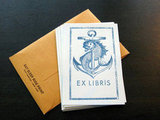 Create a nautical effect in your library with these Letterpress Bookplates ($6).