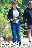 Anna Faris sported a red and blue hat as she and husband Chris Pratt took their three dogs for a walk.