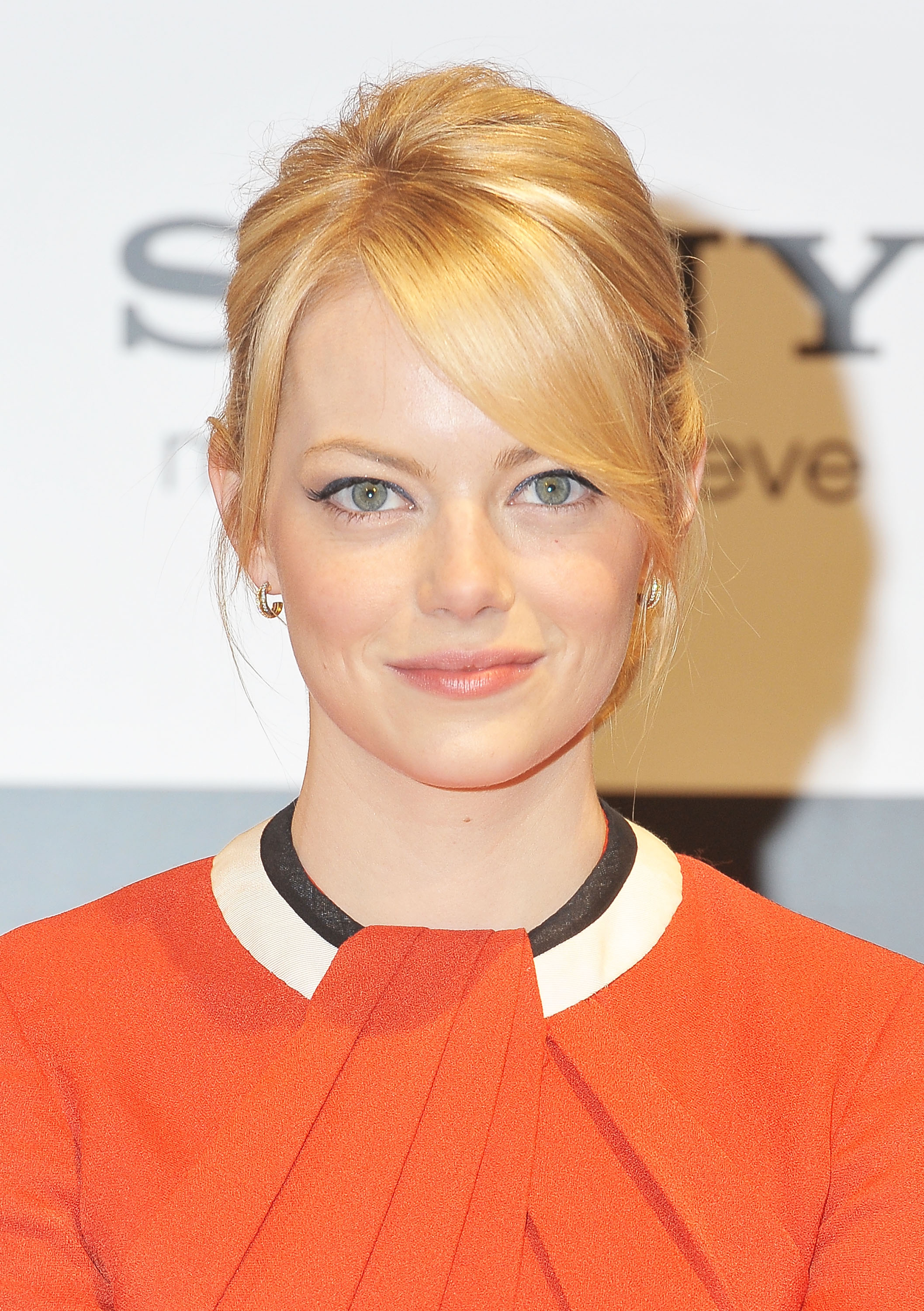 Emma Stone wore an orange dress for the press conference ... Andrew Garfield