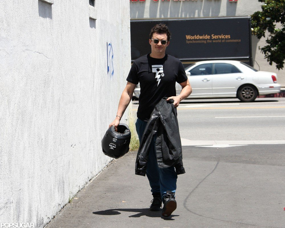 Orlando Bloom walked with his helmet in hand in LA.