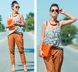 Change up staple trousers with a tribal-print tank and jewels.  Photo courtesy of Lookbook.nu