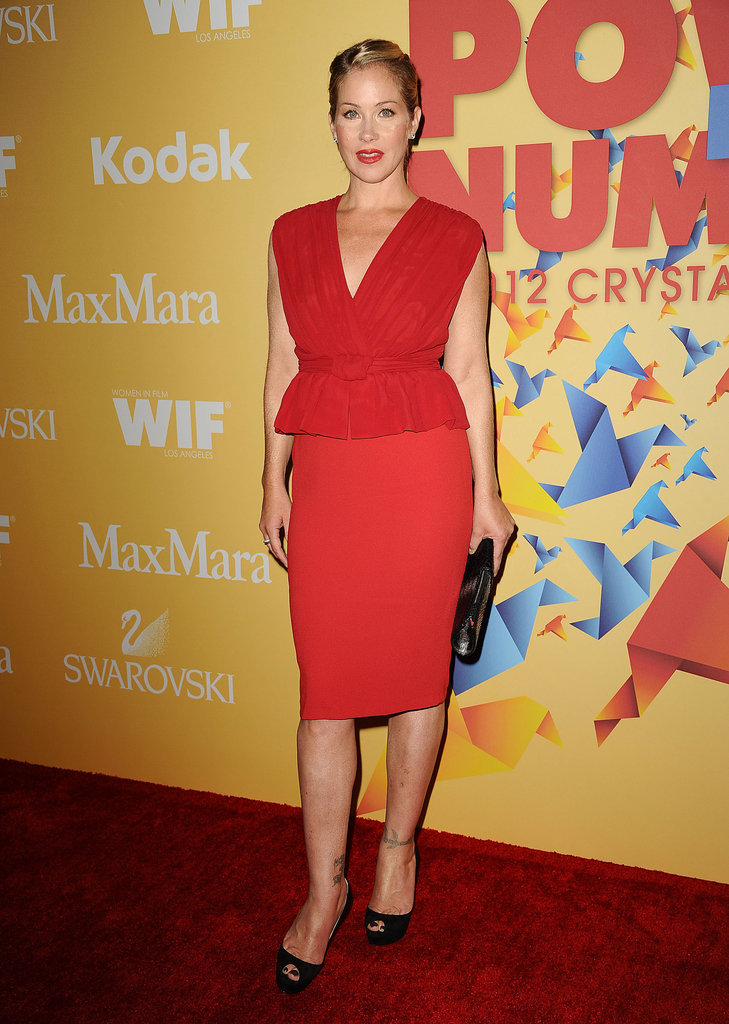 Christina Applegate brought jaw-dropping color in a fiery red Max Mara sheath dress with peplum detail at the waist and coordinating rouge lips.