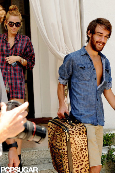 Miley Cyrus left her Miami hotel with friend Cheyne Thomas.