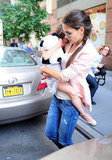 Suri Cruise cradled a stuff panda while Katie Holmes carried her.
