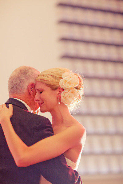 A bride teared up as she embraced her dad. Photo by Jeffrey & Julia Woods via Style Me Pretty