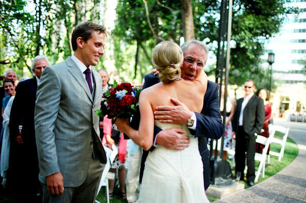 A dad hugged the bride as he gave her away during the ceremony. Photo by Docuvitae via Style Me Pretty