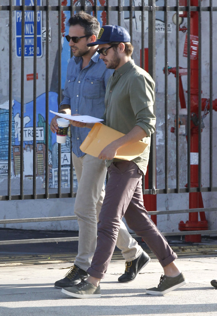 Zac Efron held a script after leaving a meeting in LA.