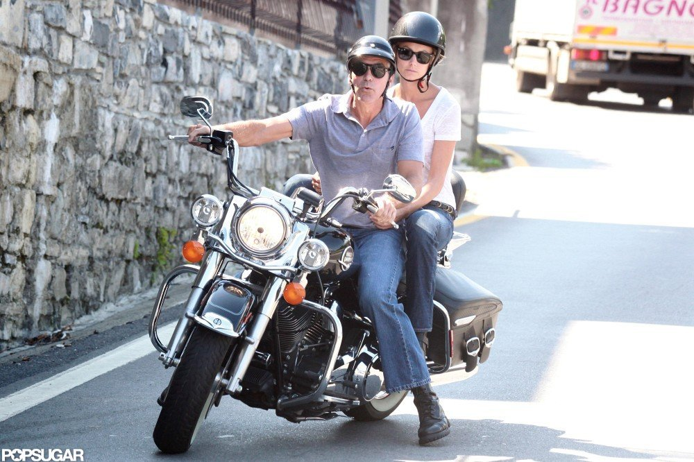 Stacy Keibler held on to George Clooney as the couple went for a motorcycle ride during their stay in Lake Como, Italy, in June 2012.