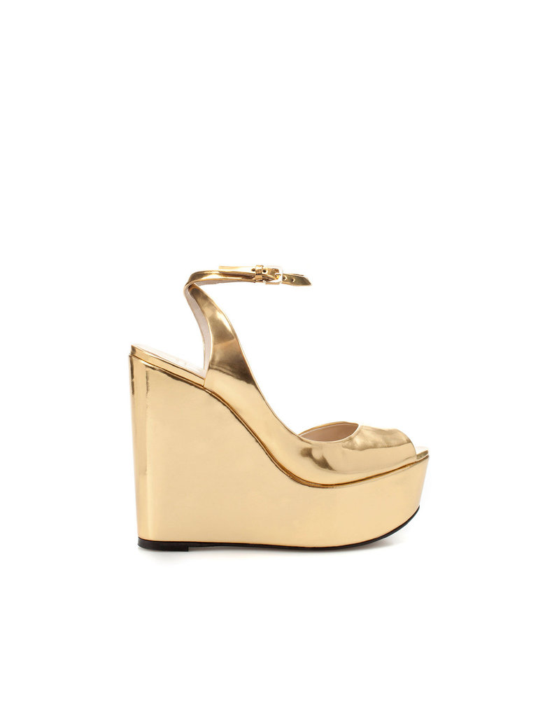 Don't fear the high-impact gold sheen on this pair of platforms — just avoid the disco vibe by pairing them with cuffed skinny jeans and a Summery button-up.  Zara Shiny Wedges ($100)