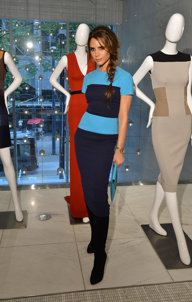 Standing among mannequins wearing her collection — we always wondered where she got her signature pose!