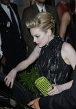 A closeup of the starlet's cool green Bottega Veneta clutch she toted at the Rome premiere.