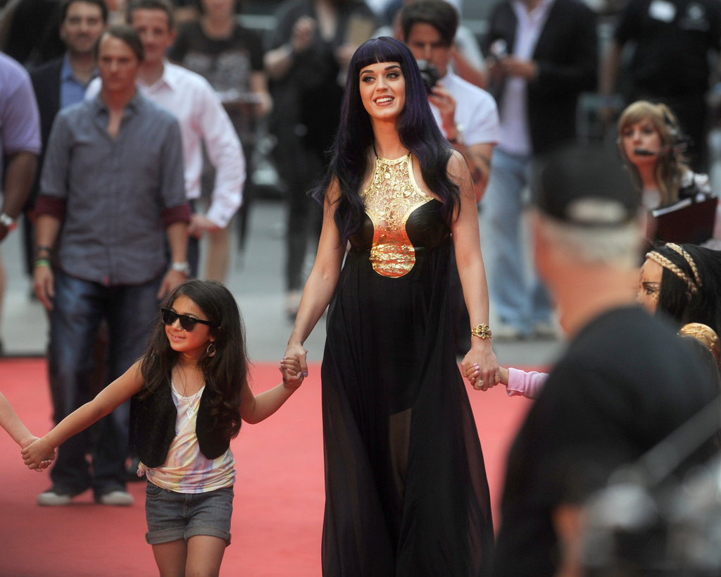Kate Perry held hands with two little girls arriving at the MuchMusic Video Awards in Toronto.