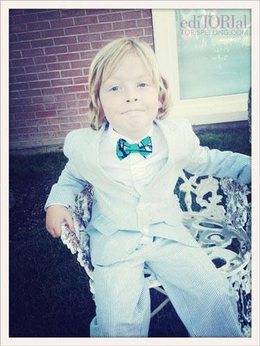 And, let's talk proud . . . Liam insisted he wear a suit and bow tie for Stella's party. He takes fashion and his role as big brother very seriously! Love him in this summer seersucker and silk bow tie made especially for him by my friend Chris of Boutaugh.