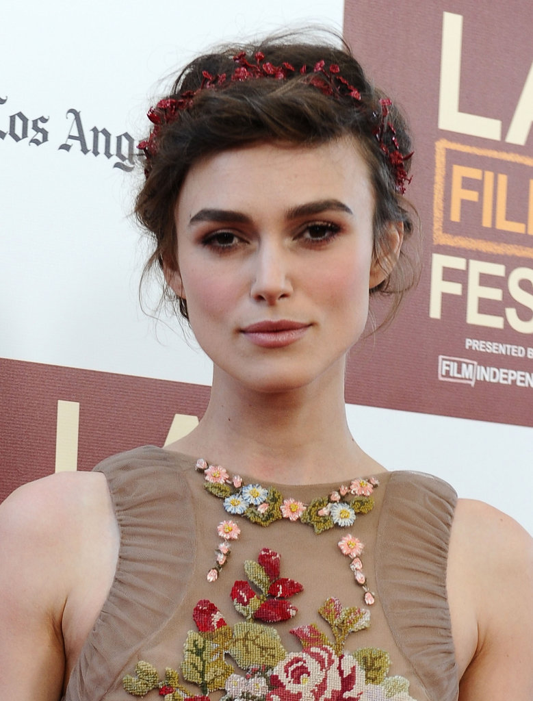 Keira Knightley wore a red headpiece for the LA premiere of Seeking a Friend For the End of the World.