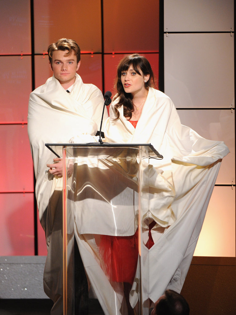 Zooey Deschanel and Chris Colfer were wrapped up in sheets on stage at the Critics' Choice Television Awards in LA.