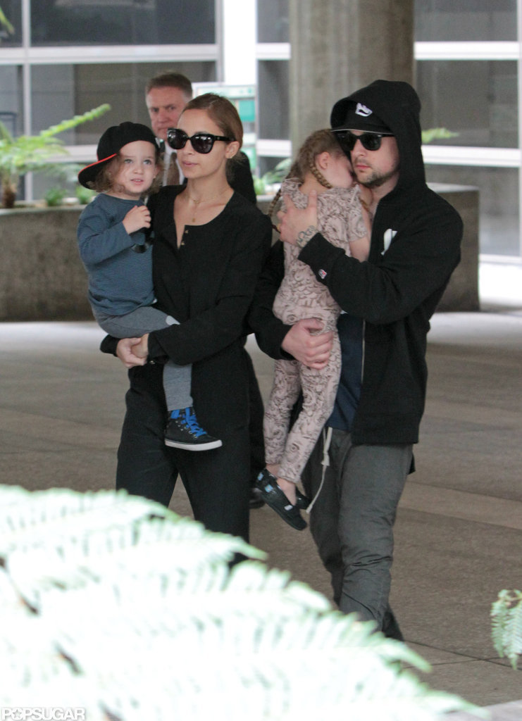 Nicole Richie and Joel Madden held on to their children, Sparrow Madden and Harlow Madden, as they walked through LAX.