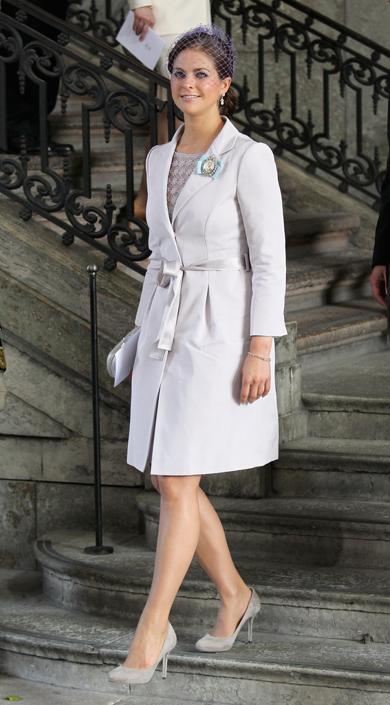 Even her more conservative looks have a touch of her girlish detail, as exemplified by her broach and a soft hue at the royal palace in Stockholm in May 2012.
