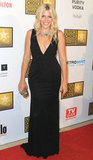 Busy Philipps accessorized a sexy black gown with a statement necklace and a jeweled gold clutch.