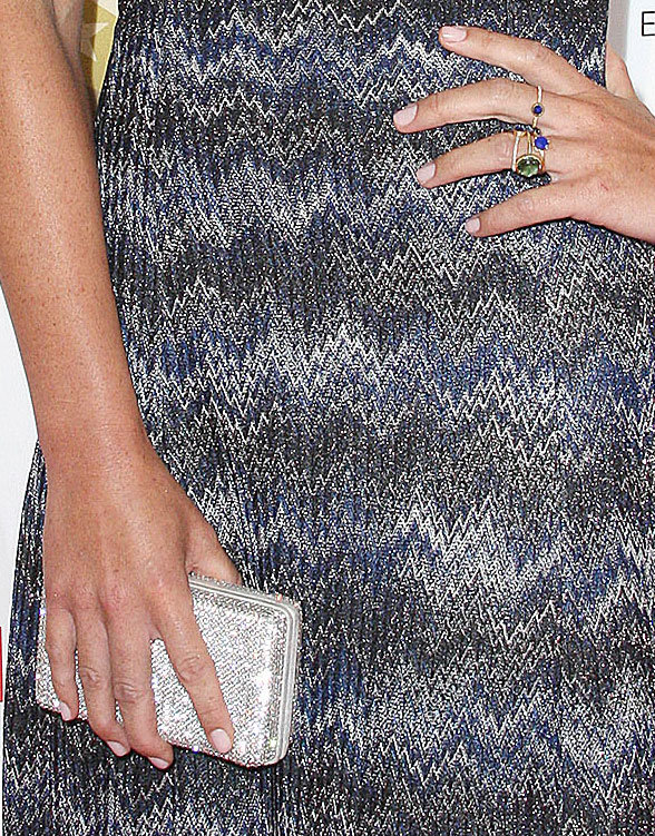 Olivia accessorized with a few stacked jeweled gold rings and a crystal-studded silver clutch.
