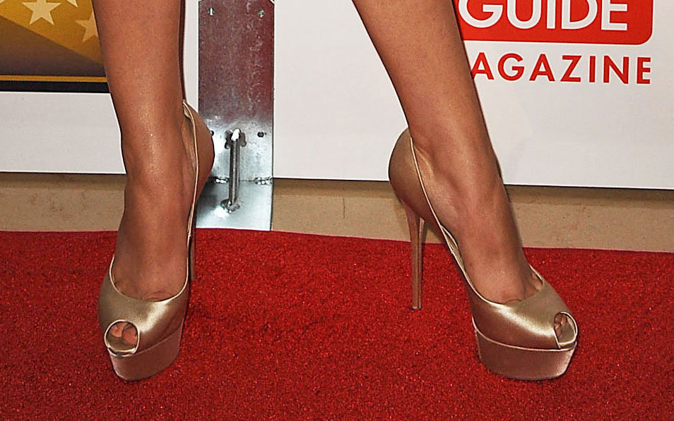 Sarah Hyland gave her look a lift with a pair of metallic platforms.