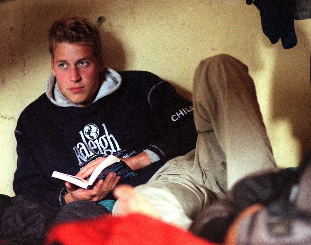 A studious Prince William read his book during a visit to the village of Torte in Southern Chile in December 2000.