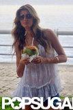 Gisele Bundchen drank coconut water at a photo shoot in Brazil.