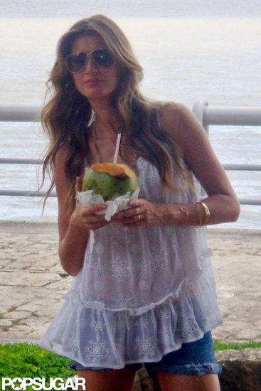 Gisele Bundchen drank coconut water at a photo shoot in Brazil.