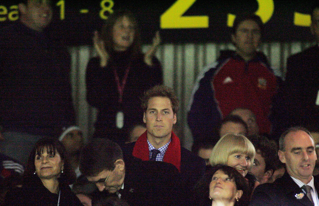 Prince William rose above the crowd during a rugby match in July 2005.