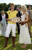 Prince William joined Claudia Schiffer to accept an award at the Porcelanosa polo match in June 2002.