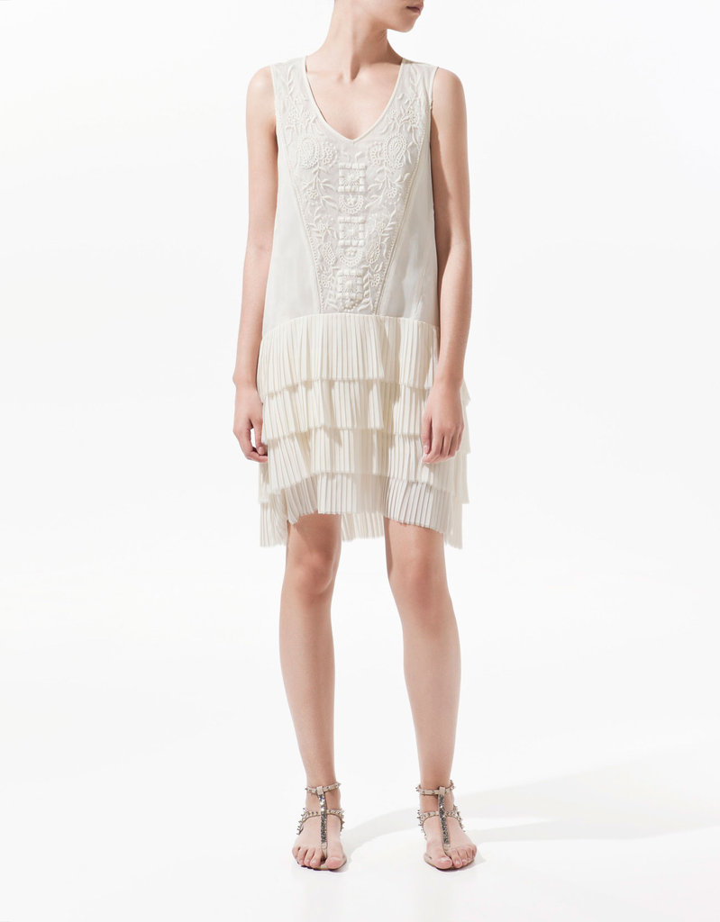 An ethereal ivory-hued LWD with a Great Gatsby feel makes us want to listen to jazz all night long with a St. Germain cocktail in hand. Zara Embroidered Dress With Frills ($100)