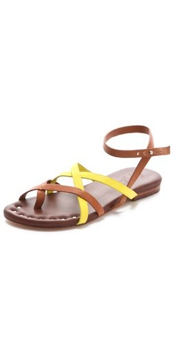 Punch up your vacation wares with a pop of neon yellow — this crisscross-meets-ankle strap sandal is sleek and quirky and makes quite a Summer statement. Matt Bernson Jack Two-Tone Strappy Flat Sandals ($160)