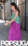 Katie Holmes wore a long purple skirt with a patterned green tank for an outing in NYC.
