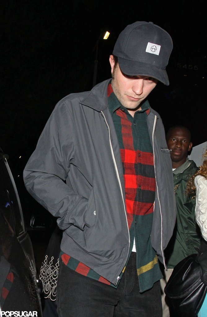 Robert Pattinson wore a flannel shirt and jacket out to a bar in LA.