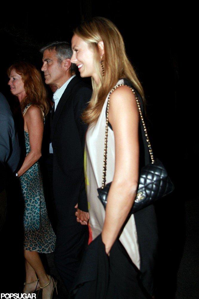 Stacy Keibler held hands with George Clooney.