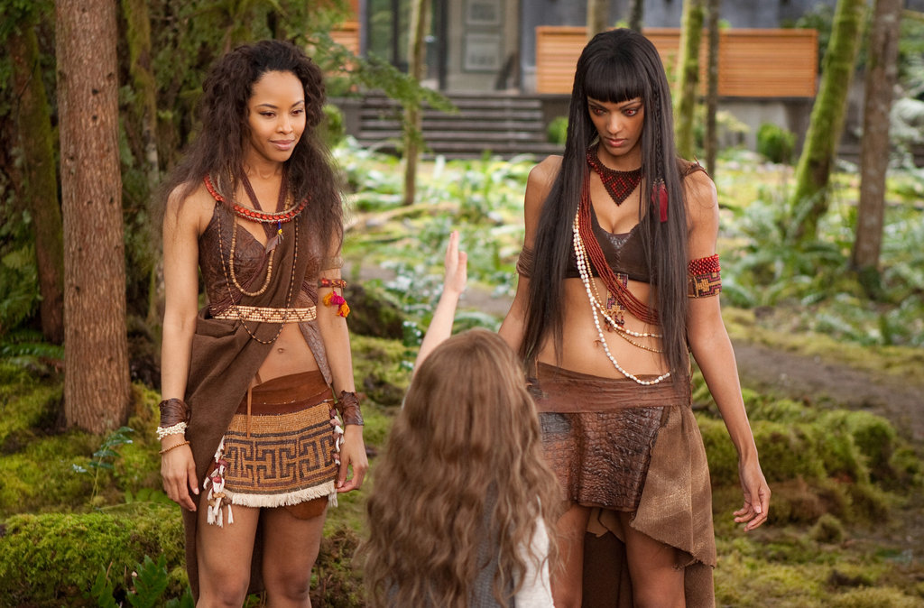 Tracey Heggins as Senna, Mackenzie Foy as Renesmee, and Judith Shekoni as Zafrina in Breaking Dawn Part 2.