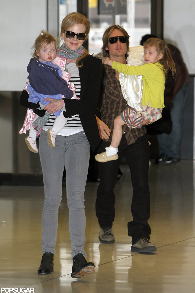 Nicole Kidman, Faith Urban, Keith Urban, and Sunday Urban walked through the airport.