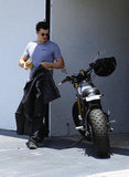 Orlando Bloom put on his shades as he hopped back on his bike.