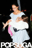 Katie Holmes carried Suri Cruise into their NYC apartment.