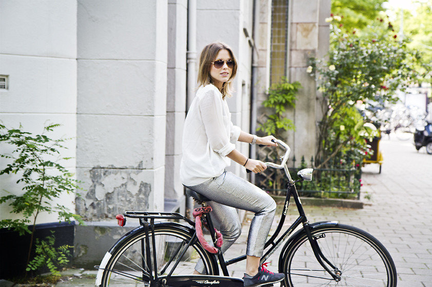 Just because you're bike-hopping this weekend doesn't mean you have to look less than stylish. Pair metallic bottoms with a open-weave top, then add your favorite sneakers to the mix. Photo courtesy of Lookbook.nu