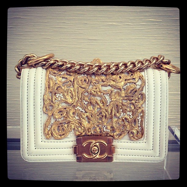 We imagine our fashion world would be totally complete with this gorgeous little Chanel bag in our closets.
