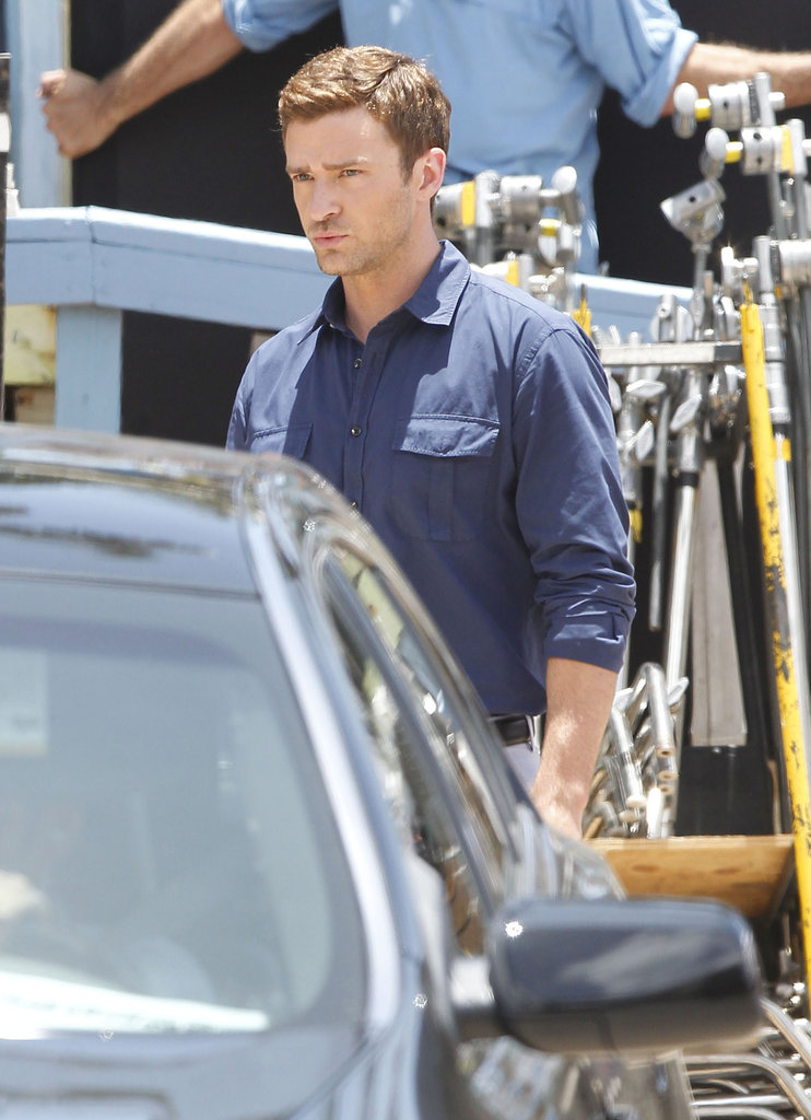 Justin Timberlake sported a blue button-down shirt on set.